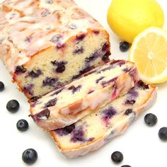 Zingy Lemon-Blueberry Yogurt Loaf made with freshly squeezed lemon juice, lemon zest, yogurt and plump blueberries is lightly brushed with a lemon syrup then drizzled with a lemon glaze. Bursting w...