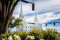 This is the view of the Brigham City, Utah LDS (Mormon) temple that I had when I realized that it look like a modern version of the SLC, Utah Temple.  I was chatting on the phone with my niece describing it to her.  I just loved this view with the flowers and the signal lights, as if to direct the traffic to it's hallowed grounds.