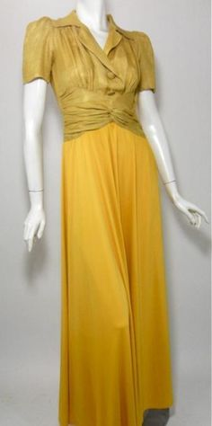 """Golden jersey rayon 40s gown  with satin twill bodice.  Decorative buttons on front,  twisted fabric """"sash""""...side  hidden metal zipper."""