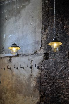 Reclaimed industrial look and feel. Lighting against plaster and exposed brick wall fits perfectly.