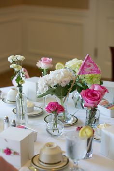 Assortment of vases for centerpiece with table number flag. Preppy Chic Bridal Shower for Ali | Sweet Kiera