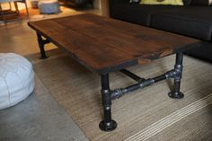 DIY industrial look coffee table. I want one for the foyer!