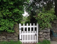 The little gate at Hill Top, the home of Peter Rabbit and his many friends. Beatrix Potter lived here too before her marriage. Owned by the National Trust. Wonderful place to visit if you are in the Lake District.