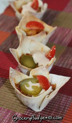 Game Day Tailgate Bites! Bite site morsels of taco meat, diced tomatoes, cheese and various toppings in a handy bite size edible bowl. These mess free munchies are great for Superbowl parties!