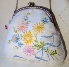 Each one of these bags is completely unique, being made from vintage embroidered table linens. They are lined with vintage or modern fabric including