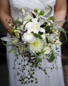 My bouquet - gardenias, ranunculuses, dahlias, lamb's ear, snowberries, and pheasant feathers.