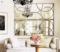 good idea -- antique mirrors hung horizontally.  Elle Decor