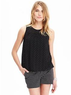 I recently purchased this tank top at Old Navy. I wear it all the time. The fabric and cut don't cling and are flattering.