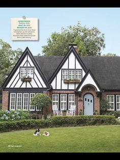 Tudor home, sharp paint job with blue door via HGTV Mag