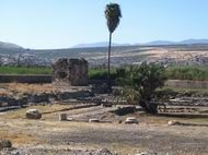 The following photo is a view from the walled area at the south-east side. The new village of Migdal is in the background.