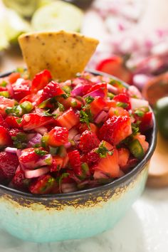 This Strawberry Jalapeno Salsa takes only 10 minutes with 5 ingredients! It's a delicious sweet and spicy salsa that is a total crowd pleaser and great for parties!