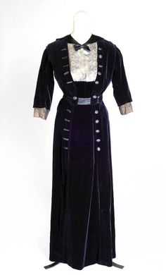 Day dress ca. 1912. Black velvet trimmed with black satin. Fastens in back with hooks. Photo: Luke Unsworth. Walsall Museums via Black Country History
