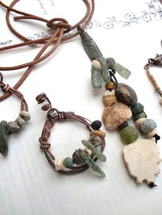 Anne-Marie Tollet - Natural Melodic: an adornment :necklace, bracelet and earrings ; primitive and tribal style, composed of ancient glass beads, stones and pieces of excavated pottery Roman period - medieval Islamic,a great antiquity: a solid brass pendant of Cameroon, is in the process of lost wax casting