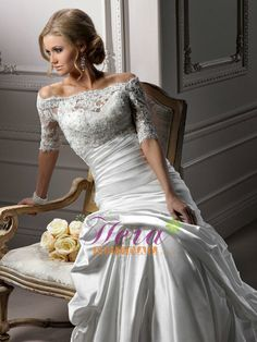 Romance satin gown available with a stunning illusion lace jacket in which scalloped lace delicately dusts the shoulder of the portrait neckline. Three-quarter length sleeves and delicate button back closure complete this extraordinary accessory. $385.00