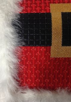 Excellent stitches for Santa's coat and belt.