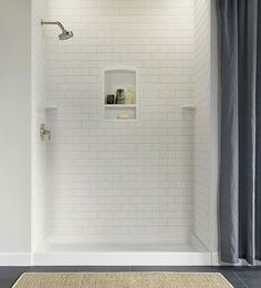 """Tile"" a new shower without breaking a sweat or dealing with grout.  A set of Subway Tile Walls, in mold-resistant polymer, includes three 36-by-72-inch glue-in-place panels; swanstone.com (for store) - This Old House"