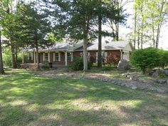 Indian Creek, newly updated brick home features 3 BR and 2 BA, large family room with eat in kitchen, formal dining room and brick fireplace in living room. New in 2014, interior painted, carpet, vinyl, bathrooms, fixtures, Heritage II roof and gutter guards and stained large back deck. Two car garage has attached 11' 4 X 7' 10 workshop with sink in Mountain Home AR