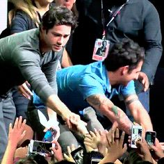 Dylan and Tyler saying hi to fans after the panel gif