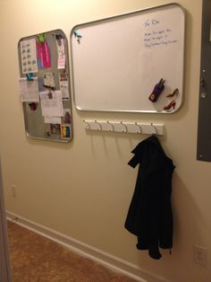 Magnetic dry erase board. Communication center. Made from automotive oil drip pans and dry erase self stick paper. 4 Large Command strips were used for each pan to adhere to wall.