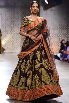 Rimple and Harpreet Narula runway couture 2016 collection online. a brown raw silk lehenga with gold tilla dori work floral paisley motifs all over. Shop this now at www.carmaonlinesh... #ICW2016 #carmaonlineshop #indian #designer #Rimple&Harpreet #ethnic #heritage #India #craft #lehenga #wedding #sequin #zardozi #embroidery #whimsical #shimmer #couture #shopnow #shoponline