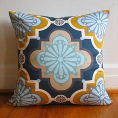 geometric shapes and aqua/orange/navy/cream color combo... love.