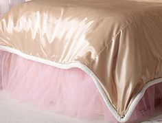 Lovely double layered pink tulle over latte satin.
