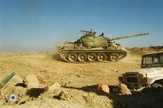 Iranians drive T-55 tank at the frontlines of Iran-Iraq War.