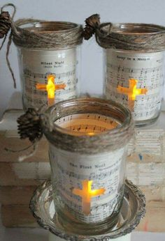 + Ideas for Beautiful and Ingenious Mason Jar Crafts christmas mason jars, three jars decorated with sheet music, and tiny fir cones tied with string, a cross shaped window reveals, a lit candle in each jar Pot Mason Diy, Mason Jar Gifts, Diy Crafts With Mason Jars, Candle Gifts, Candle Craft, Vintage Christmas, Christmas Diy, Christmas Decorations, Church Decorations