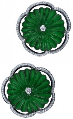 The Emerald Lotus Earrings of Rang Maha Gently carved emeralds, surrounded by delicate white diamonds, are infused with the spirit of the exquisite marble lotus fountain of the Red Fort Palace in Delhi, India.
