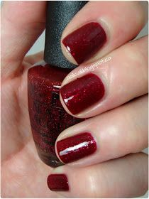 OPI:  Underneath The Mistletoe (red jelly semi-packed with silver, red and pink glitter).  Mariah Carey 2013 Holiday Collection.