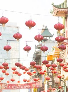 Bright red lanterns crisscross the streets of Chinatown in San Francisco.