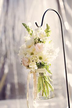 shephard hooks and hanging mason jars filled with flowers