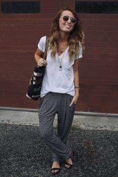 remember when I said that I would never ever ever wear harem pants? - The Daybook: Shoes:  Shoemint, Pants: Jennifer Lopez for Kohls  Tee: Urban Outfitters, Bag: Target, Glasses: Target. Necklaces: Urban Outfitters {crystal}, Von Eshna {E necklace} and Target.