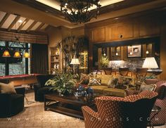 Eclectic Great Room with Pendant light, Built-in bookshelf, High ceiling, Exposed beam, Chandelier, Crown molding, can lights