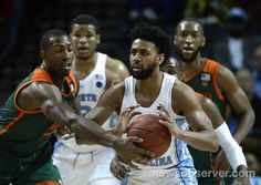 Miami guard Davon Reed (5) goes to steal the ball from UNC guard Joel Berry II (2) in the first half during the ACC Men's Basketball Tournament at the Barclays Center in Brooklyn, N.Y. Thursday , March 9, 2017.