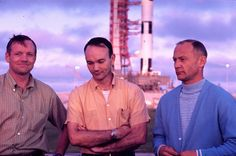 Neil Armstrong, Mike Collins and Buzz Aldrin with the Saturn V rocket that would take them to the moon in the background, Cape Canaveral, Florida, July 1969.