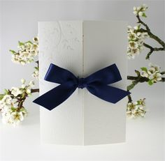 Verona Navy Blue Wedding Invitation - deep floral emboss gatefold card held together by a regal navy satin bow.