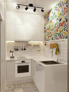Modern Kitchen Injecting Color Into A Tiny White Space More - Don't feel limited by a small kitchen space. Here are fifty designs for smaller kitchen spaces to inspire you to make the most of your own tiny kitchen. Small Apartment Kitchen, Micro Apartment, Kitchen Small, Cozy Apartment, Kitchen White, Kitchen Modern, Minimalist Kitchen, Micro Kitchen, Apartment Ideas
