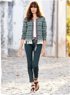 Channeling a global-chic, boho vibe, our mid-weight, jacquard knit cardigan is patterned after a traditional kilim in hues of teal and white pima, accented in red. Framed with a contrast border, hand-tied macrame fringe adds a free-spirited finish to the hem. Buttonless placket; full-length sleeves.