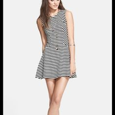 """Free People Striped 'Cha Cha' Mini Dress (M) The classic fit-and-flare silhouette gets a modern update with a trending striped print & an exposed back zipper. Figure-flattering tailoring on the bodice completes this chic style.  * Round neckline. * Sleeveless. * Approx. Length: 31"""" * 64% Polyester, 33% Rayon, 3% Spandex. * Machine Wash Cold. Tumble Dry Low.  * Imported.  SIZE:  Medium   COLOR:  Antique Ivory Combo ORIG. RETAIL:  $98.00    *** SHIPPING : Going out of town! UNABLE to ship TUES…"""