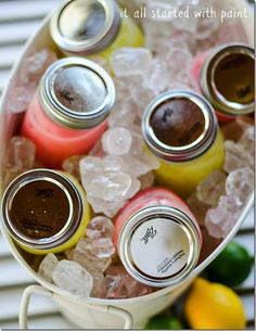 Make individual mixed drinks in mason jars and put on ice in cooler; shake and drink and enjoy!