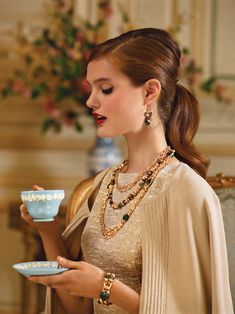 Perfect hair make-up with camel outfit and tea!  she's so timeless and classy