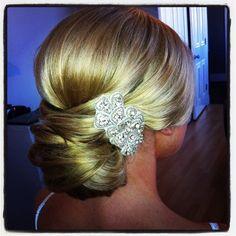 Lovely wedding hair updo with diamond brooch   Wedding Hair by Charlotte Belk