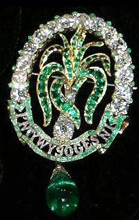 On the occasion of her marriage, Princess Alexandra of Denmark, who married the Prince of Wales (later Edward VII) was given by the Ladies of North Wales a large emerald and diamond oval brooch with an emerald and diamond leek in the centre and cabochon emerald drop, along with matching earrings which is now worn by the Duchess of Cornwall on occasion.