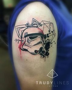 Graphic stormtrooper tattoo on the right upper arm.