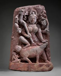 """Durga (Sanskrit: दुर्गा); meaning """"the inaccessible"""" or """"the invincible"""" is a fierce form of the Hindu Goddess or Devi. She is depicted with multiple (variously, up to eighteen) arms, carrying various weapons and riding a ferocious lion or tiger. She is often pictured as battling or slaying demons, particularly Mahishasura, the buffalo demon.900–1000  India; Mathura region, Uttar Pradesh state;  sandstone;  Asian Art Museum of San Francisco, the Avery Brundage Collection"""