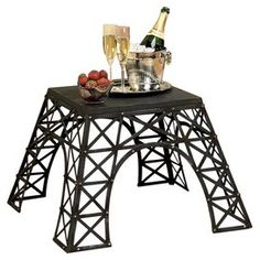 """Metal end table with latticed legs inspired by the base of the Eiffel Tower.  Product: End tableConstruction Material: MetalColor: BlackFeatures: Eiffel Tower-inspired motifDimensions: 17"""" H x 26"""" W x 26"""" D"""