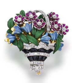 An enamel, diamond and gem-set brooch  designed as a basket of polychrome enamel flowers, highlighted by calibré-cut, buff-top onyx and rubies, accentuated throughout by old European, old mine, and baguette-cut diamonds; mounted in platinum and eighteen karat gold; length: 1 1/2in.