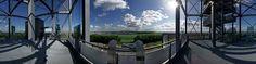 """Dieses Panorama zeigt den Blick vom Kopf des Aussichtsturms """"Indemann"""" auf der Halde """"Goltsteinkuppe"""" bei Lucherberg in der Gemeinde Inden im Kreis Düren in Deutschland. Man hat Blick auf die Sophienhöhe, den Braukohletagebau """"Tagebau Inden"""" und das Kohlekraftwerk """"Weisweiler"""" im Hintergrund.Für weitere Informationen besuchen Sie:http://www.indeland.de/index.php?id=60http://de.wikipedia.org/wiki/Indemann..."""
