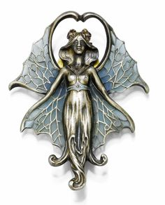 Enamel buckle, circa 1900. Decorative Art Nouveau clip / buckle in the form of a dragonfly in female form, the wings decorated with plique à jour email in different shades of blue